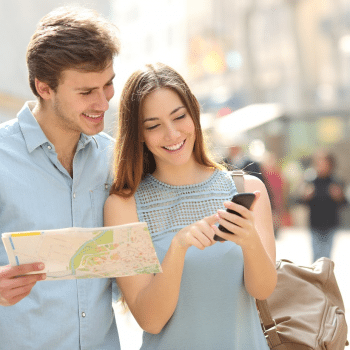 Travelers using map and mobile navigation